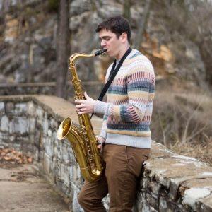 justin loizos playing saxophone