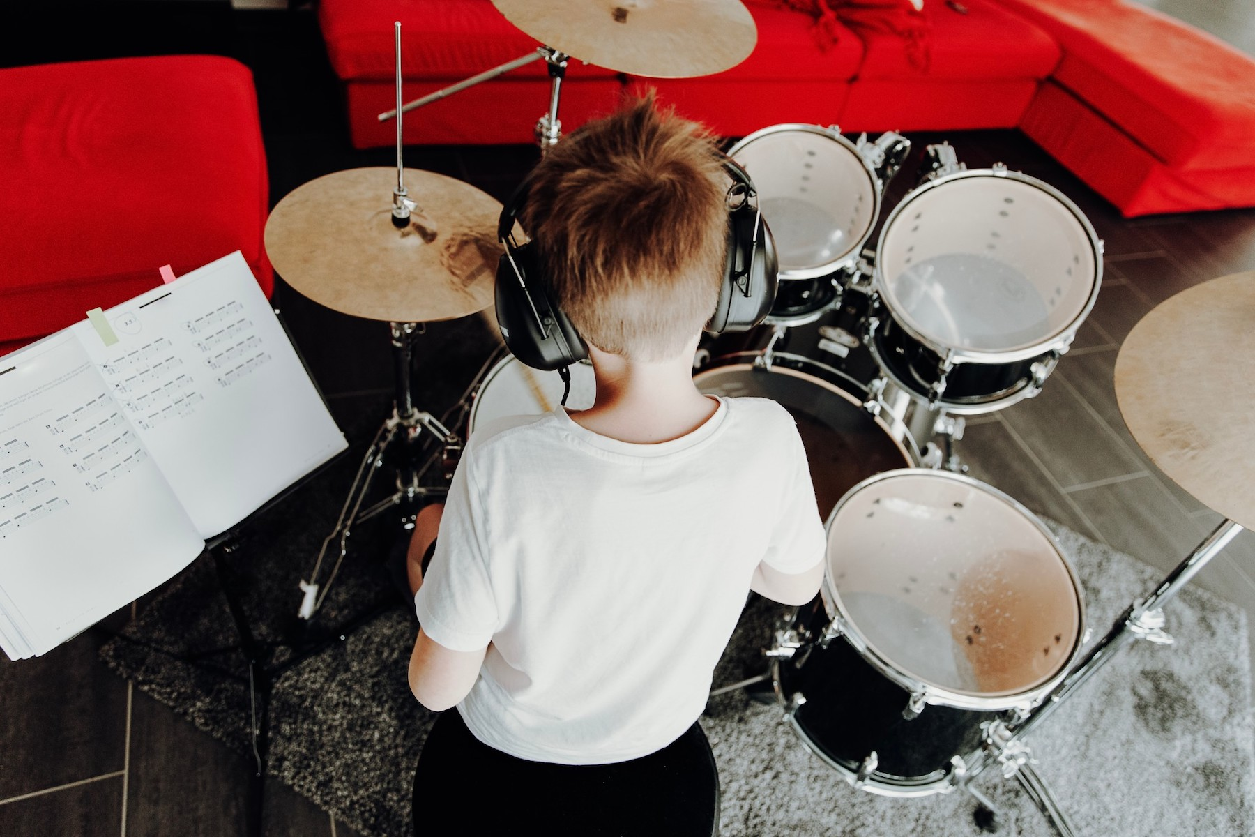 little kid practicing drums