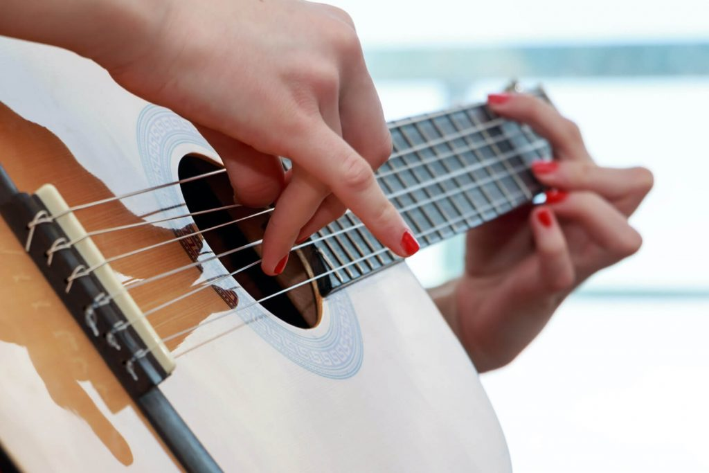 someone playing guitar closeup