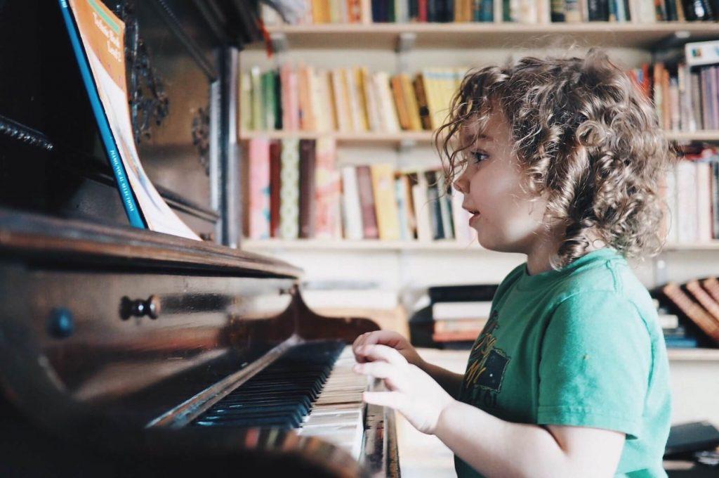 small kid playing piano