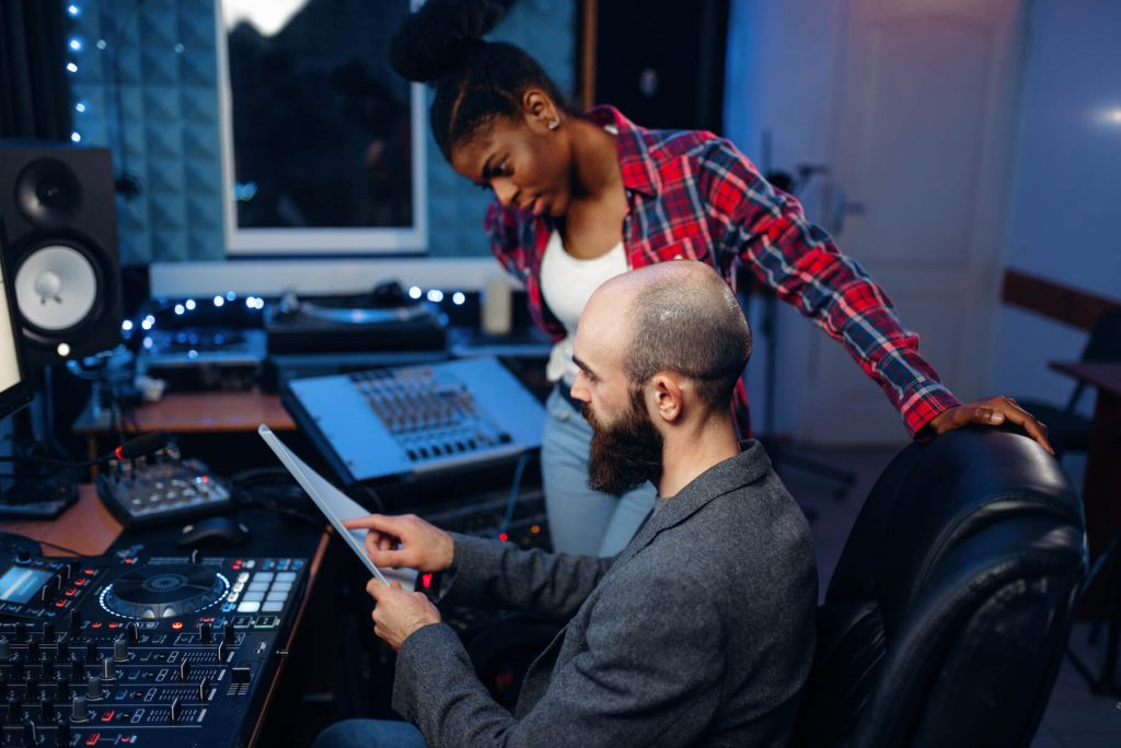 producer and artist in recording studio