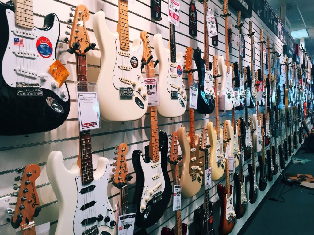 different guitars on display at a music store