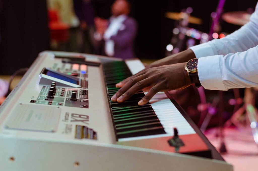man experiencing benefits of music on piano