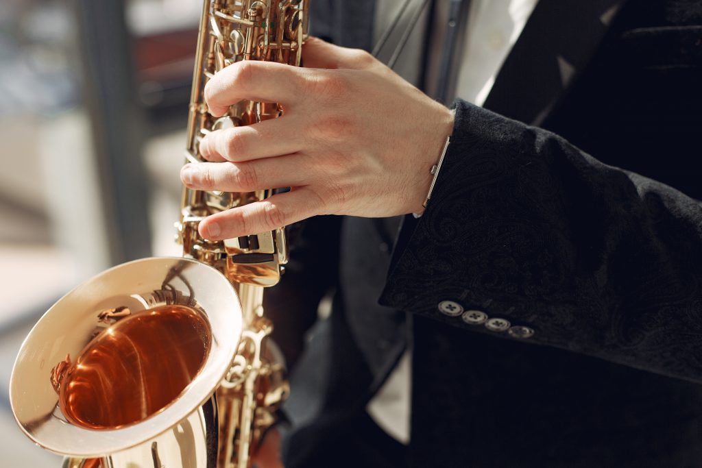 person experiencing benefits of music on saxophone