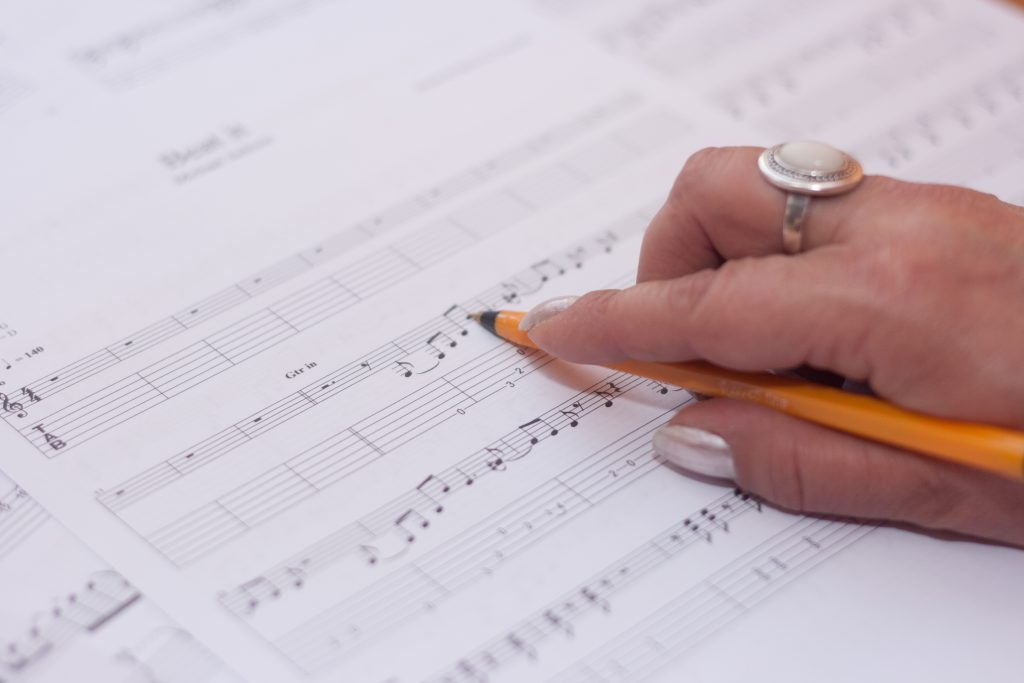 student learning music