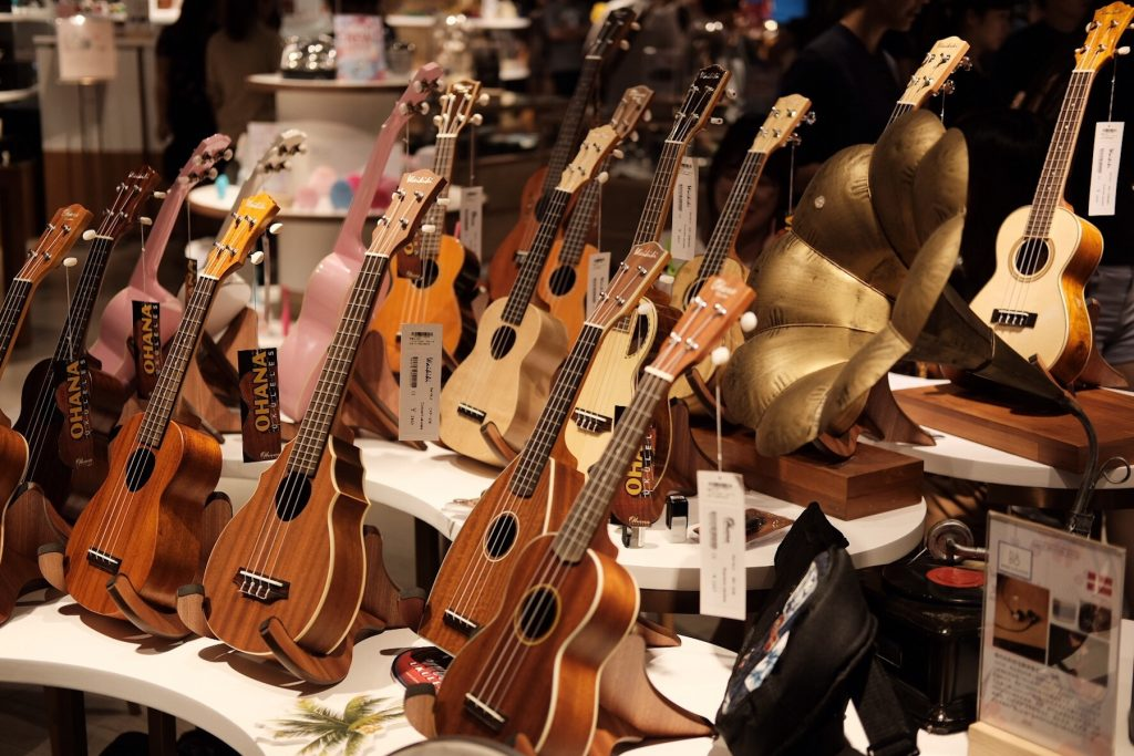 different ukuleles on display at a store