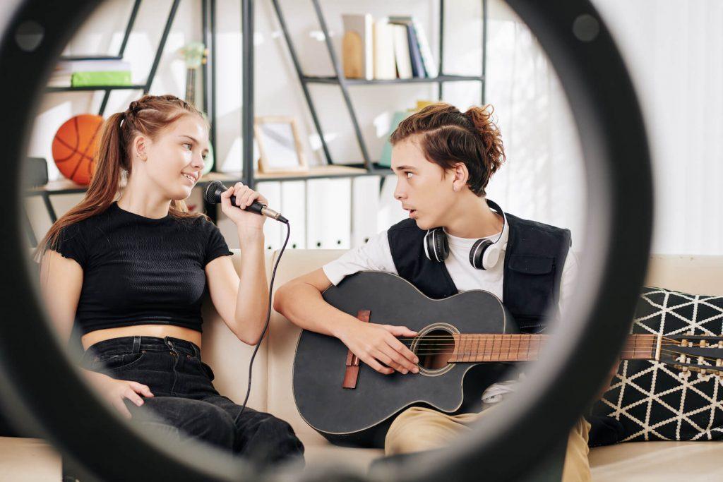 girl singing and boy playing guitar