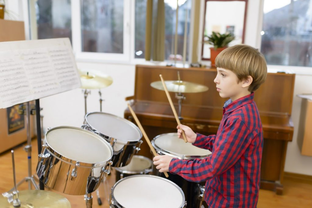 Beginner learning how to play drums