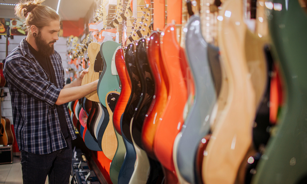 man who decided to buy first electric guitar