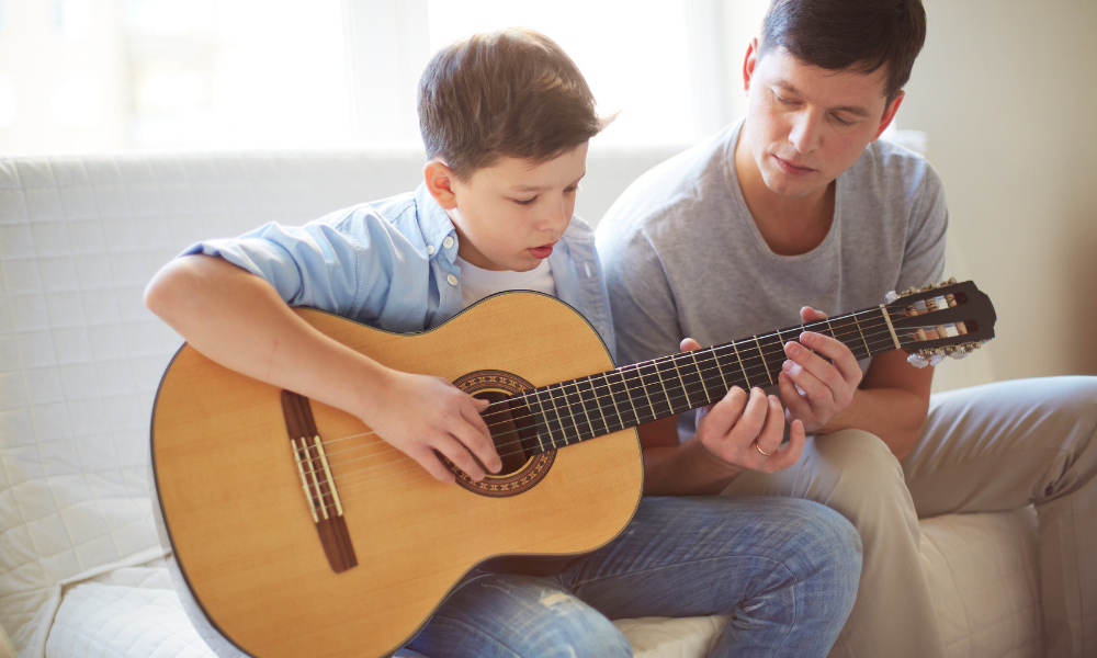 child learning the guitar for the first time