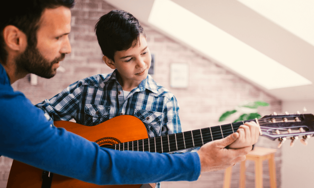boy taking classical guitar lessons