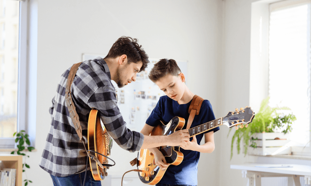 boy taking electric guitar lessons
