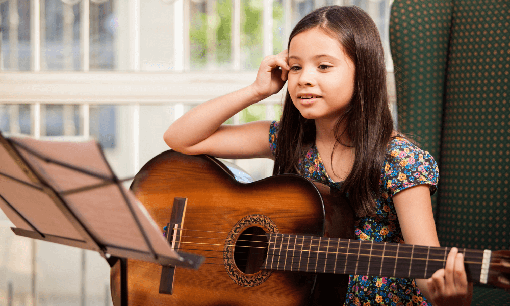 girl taking classical guitar lessons