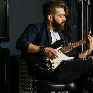 musician with guitar and amp