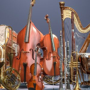 A display of rental instruments available for any musician, from drums to horns and a harp.