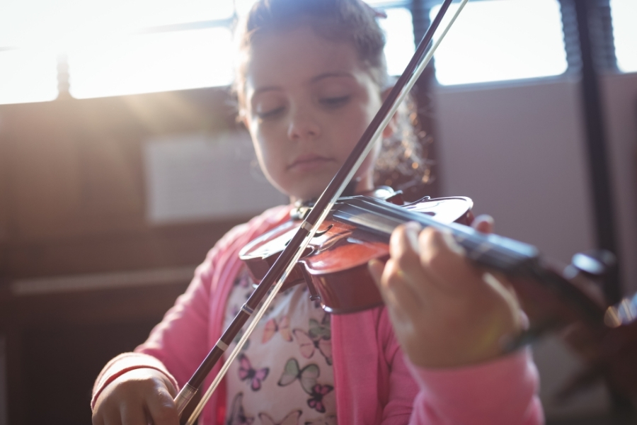 Girl student rehearsing violin